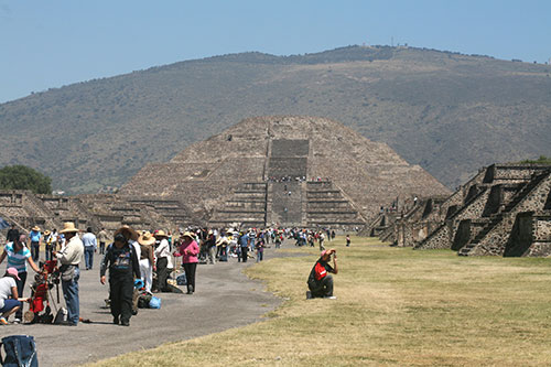 A large number of tourists is shown in front of the Pyramid of the Moon at the ancient city of Teotihuacan, Mexico.